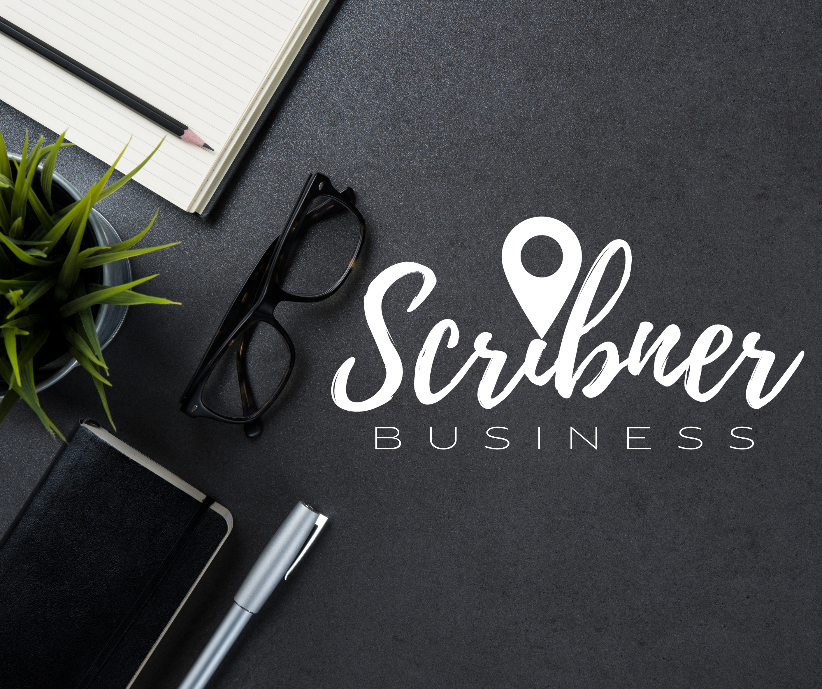 Aerial view of desk with Scribner Business written across it