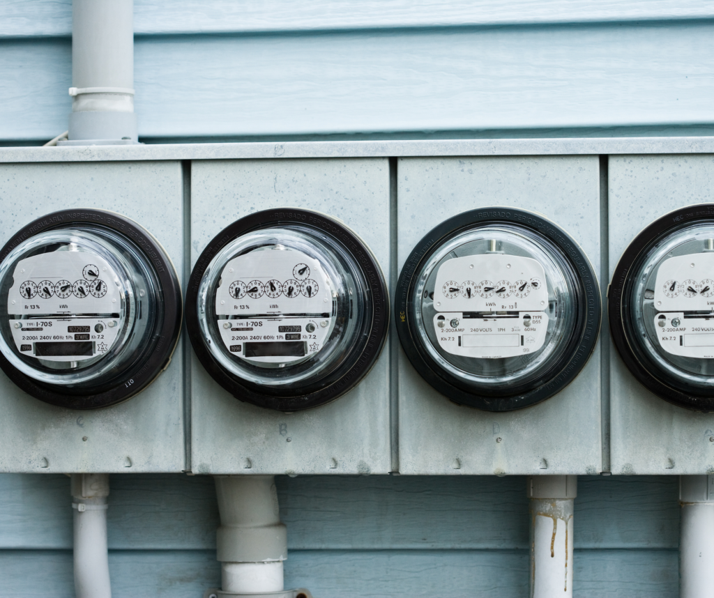 utility meters lined up on a house